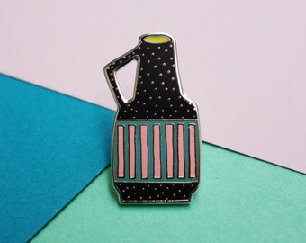 A Black But Colorful Vase Pin