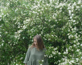 Wide and pleated linen dress with 3/4 sleeves and comfy side pockets in Different colours