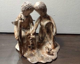 """The power of love"" handmade ceramic figurine"