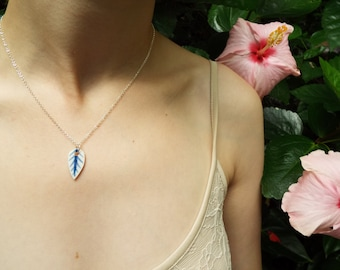 Porcelain blue and white leaf necklace,  glazed and on a sterling silver 18'' chain