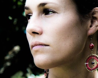 Red, brown and gold large circle Maasai beadwork dangle earrings.