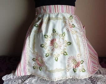 A very feminine waist apron, vintage inspired with floral embroidered front panel