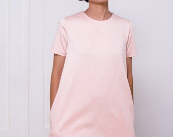 Cotton A line mini dress with short slevees and side pockets in blush