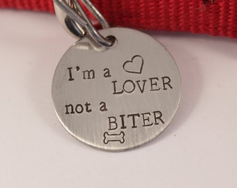 "1.25 inch ""I'm a LOVER, not a BITER"" Personalized Pet ID tag (Pet's name & your phone on back)"