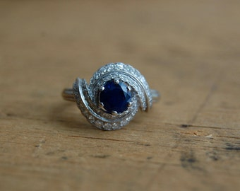 Vintage sapphire and diamond swirl French cocktail ring