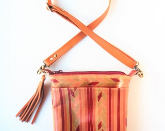 Leather crossbody bag in fall colors.