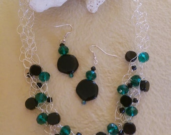 Black opaque stone with green crystal bead crocheted silver wire necklace and earrings.