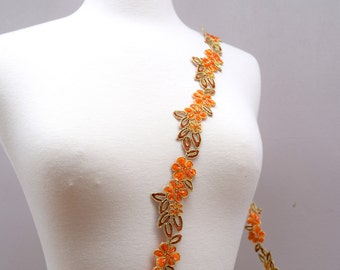 Orange Lace With Camel and Gold Accents Beaded With Flowers and Leafs with Non-Straight Edges