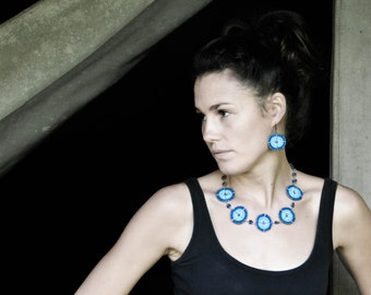 Blues, silver and gunmetal circular Maasai bead-work earrings.