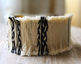 Bracelet cuff, son of off-white and black jade, and braids