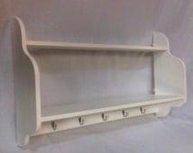 Handmade wooden white nursery shelves with book shelf and hooks