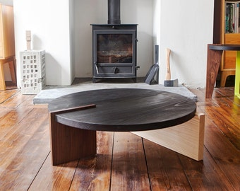 Modern round wood table. Minimal hand made Singnature contemporary coffee table, solid wood, black top, walnut and ash