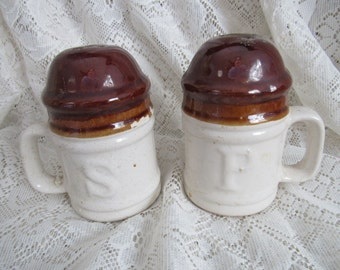 Brown and White Stoneware Salt and Pepper Shakers