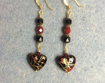 Ruby red and gold acrylic heart bead dangle earrings adorned with ruby red and black Czech glass beads.