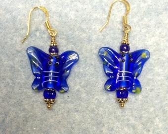 Bright blue lampwork butterfly bead earrings adorned with bright blue Czech glass beads.