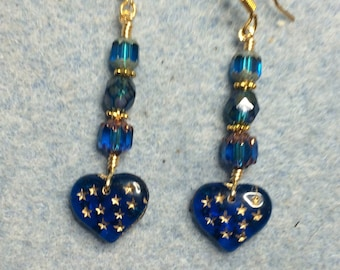 Turquoise blue Czech glass heart bead dangle earrings adorned with turquoise blue Czech glass beads.