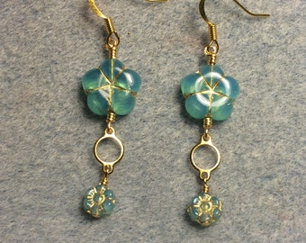 Milky aqua Czech glass puffy flower bead dangle earrings adorned with gold circle connectors and milky aqua Czech glass poppy beads.