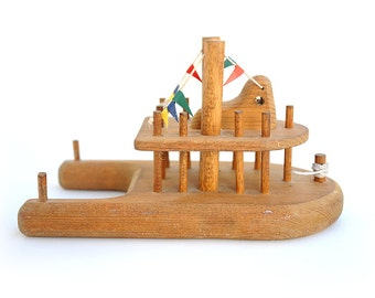 Tugboat with flags and 'rope' | Vintage wooden toy boat