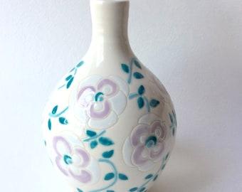 Porcelain bud vase with floral design