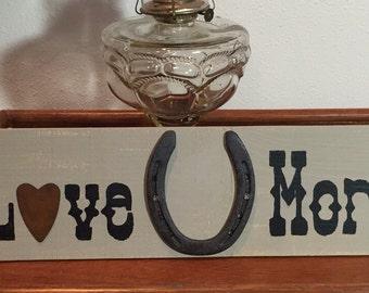 Love U More sign