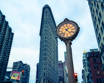 Flat Iron Building and clockpost in New York City