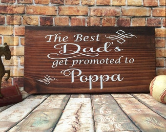 The best dads get promoted to Poppa stained wooden sign