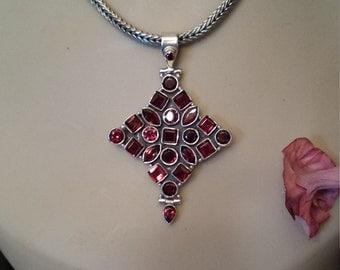 sterling silver multiple faceted garnet pendant