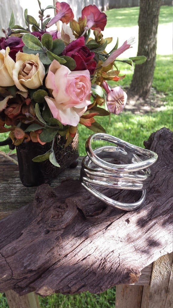 Sterling silver bangle four tiered attached layering