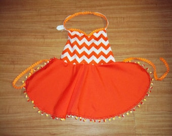 Child's apron- orange and white-flaired skirt