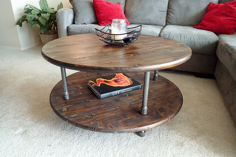 Round rustic industrial pipe coffee table for Rustic pipe table