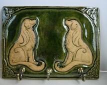 Ceramic Celtic dogs (Golden Retrievers) key tidy in a moss green glaze.