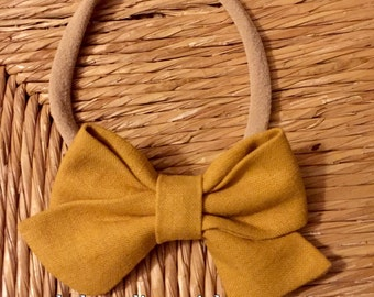 Mustard color hair bow.. yellow hair bows.Sailor bows.. nylon headband.. little girl bows. baby headbands