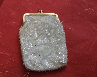 Beaded and sequined vintage pouch, lined with white satin.
