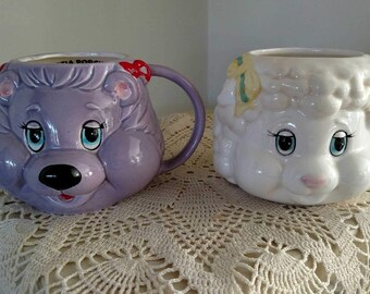 Woolma lamb and Portia Porcupine mugs. set of 2. American greeting cards 1984. 4 inches tall. Get Along Gang. Good condition on both.