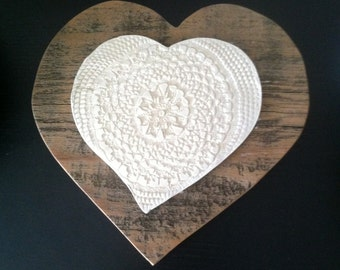 Ceramic heart on recycled wood