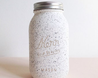 Large Kerr mason jar painted in white with a speckled finish