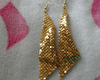 Gold earrings for a night out
