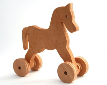 Wooden toy Horse. A Push Toy for Kids