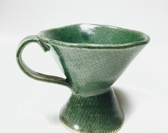 Green tea cup with neting pattern