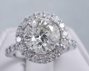 Pretty 3.60 ctw Round Cut Diamond Ring with a 2.67 carat Round Cut J Color/SI2 Clarity Enhanced Center Diamond