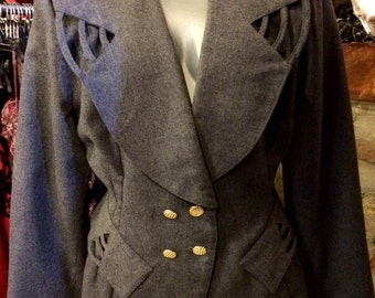 1980's wool blaser, made in italy, with huge shoulder pads. Size S.