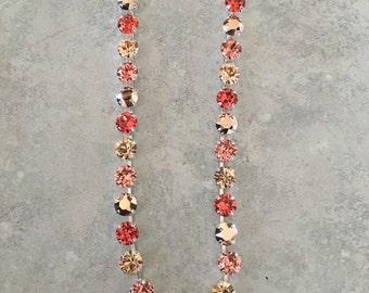 Peach/orange swarovski crystal necklace with rose gold metallic stones