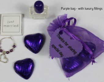 Purple wedding favour bags with a selection of fillings - heart, butterfly, flower or lovebird theme