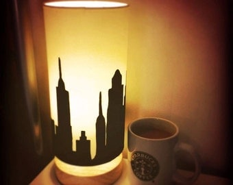 City Skyline Silhouette on Cream, Large Cylinder, Wooden Base Lamp