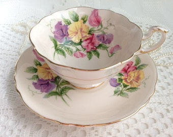 Beautiful Paragon China Tea Cup and Saucer, Pink with Floral Cup Interior, 1960-63