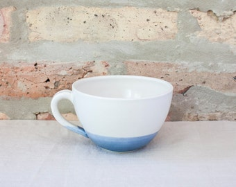 Blue Cafe Coffee Cup by Barombi Studios