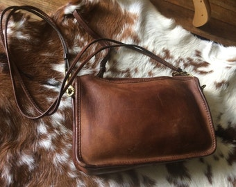 Vtg.Brown leather coach clutch/cross body bag made in NYC