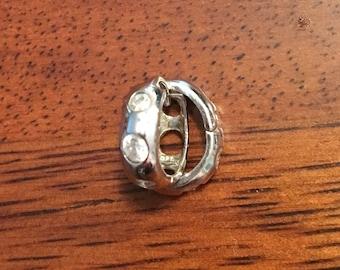 Sterling silver huggie earrings with cubic zirconia