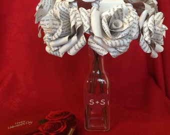 A dozen book page paper roses with glass vase personalized with initials paper flowers valentine bouquet