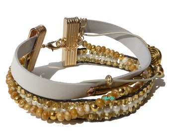 White and gold multi-strand cuff bracelet